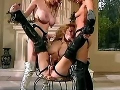 Four gorgeous lesbians in boots play with pussies