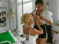 Blonde lesbian seduces chick on bed