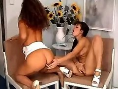 Horny lesbians have fun with dildo